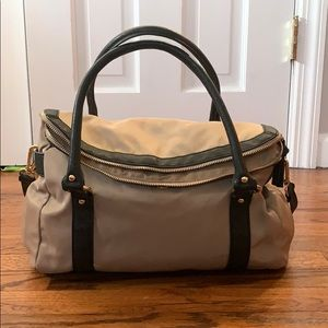 Tan and black bag with detachable shoulder strap